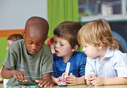 Pre-Kindergarten Program: three boys learning