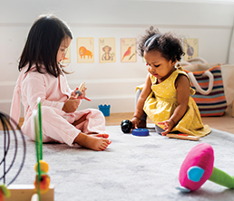 Corporate Day Care Program: Two girls playing