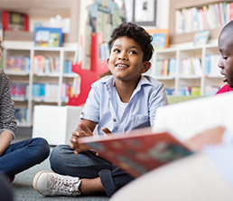 Elementary School Program: Child listening to his teacher reading