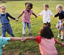 Extended Day Program: Children playing and holding hands