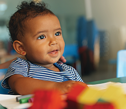 Infant & Toddler Program: Toddler with a smile on his face