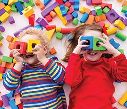 Preschool Program: Two kids playing with blocks