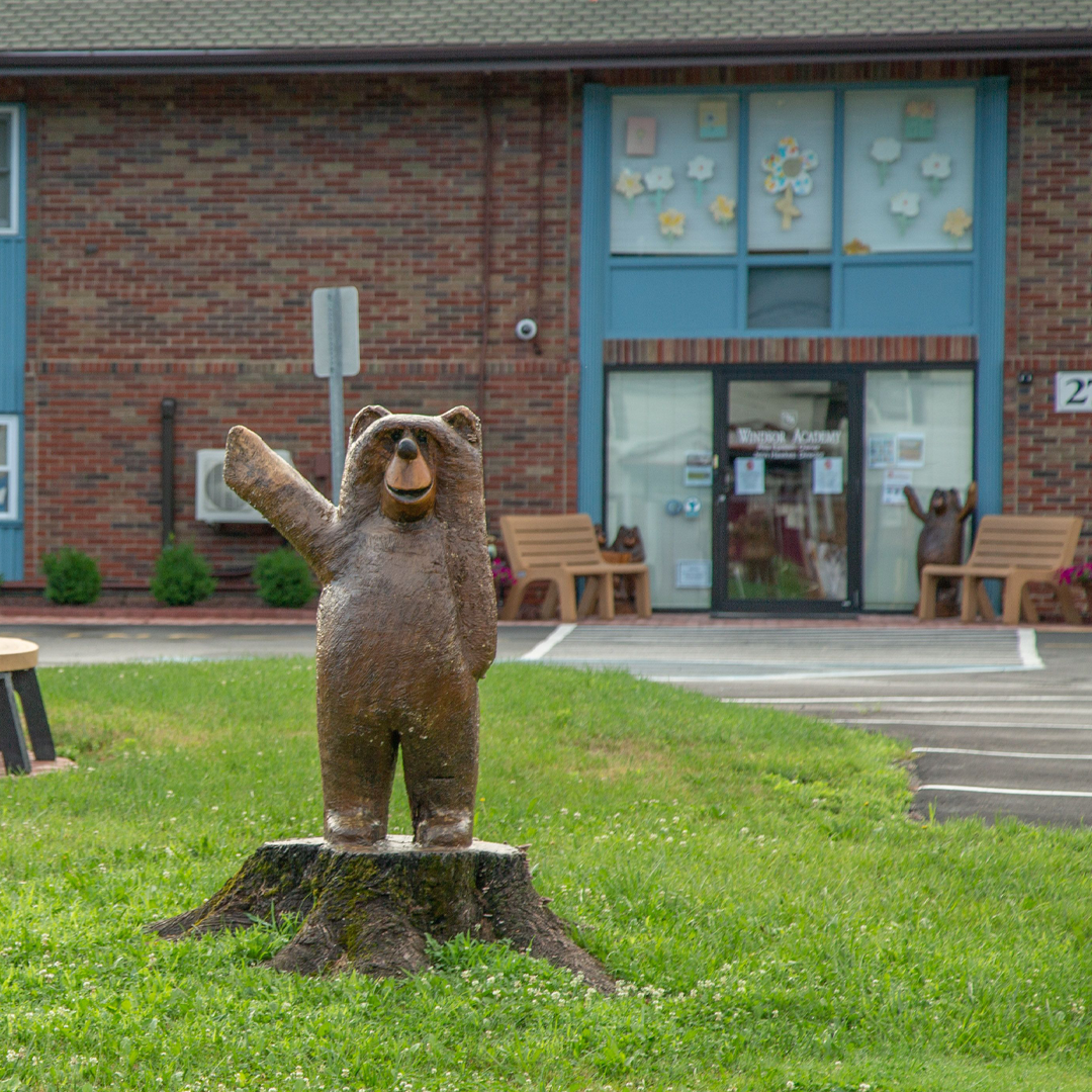 Front of Windsor Academy Building with wooden bear