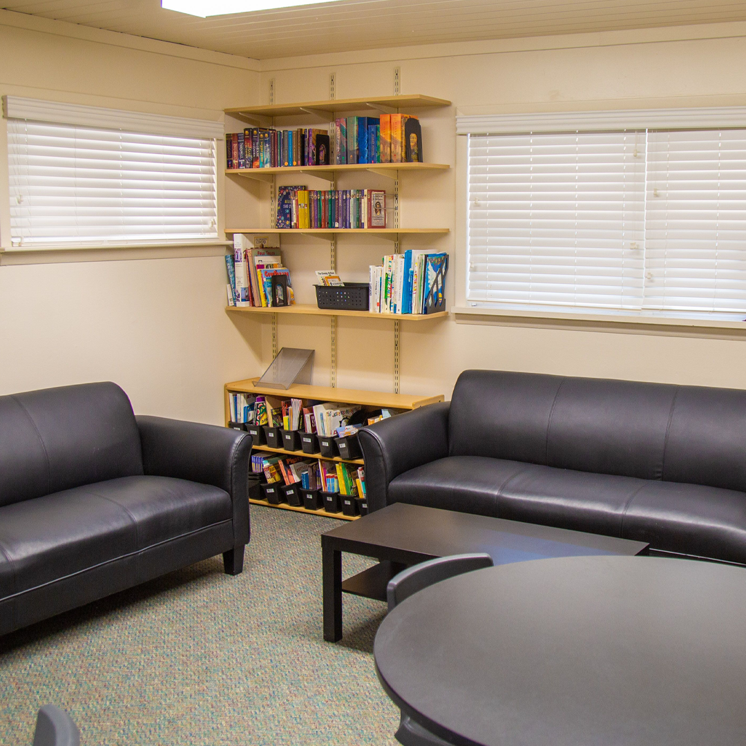 Staff room with couches and bookshelves