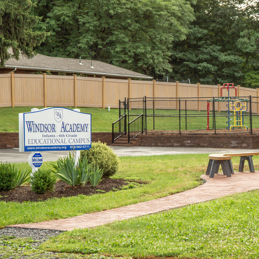Windsor Academy sign - Front Patio and a view of a playground