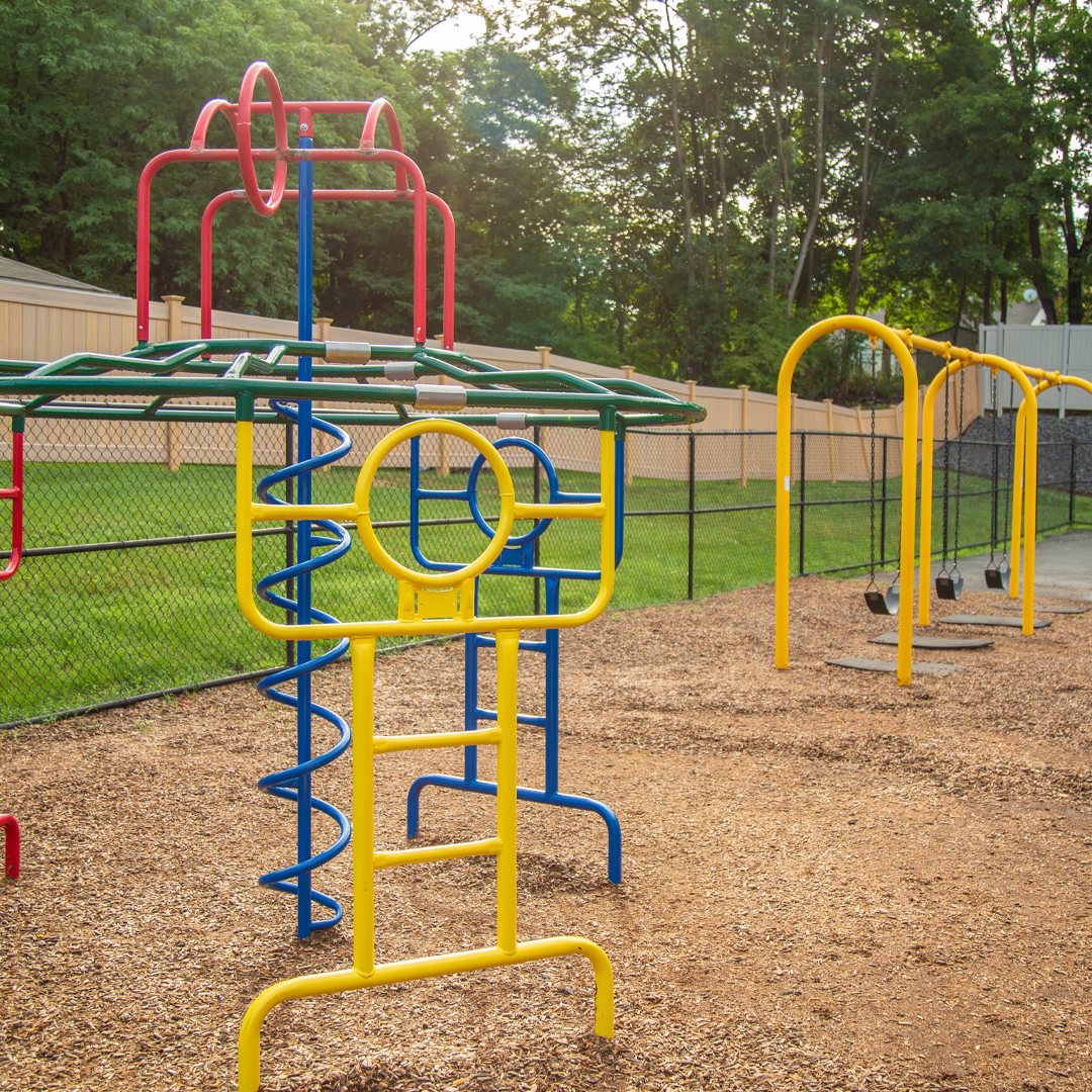 Jungle gym and swings in the playground for older students