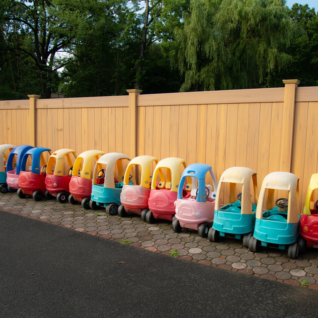Ride on playground with a row of toy cars