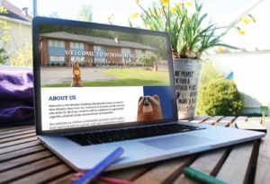 laptop image with new Windsor Academy website preview